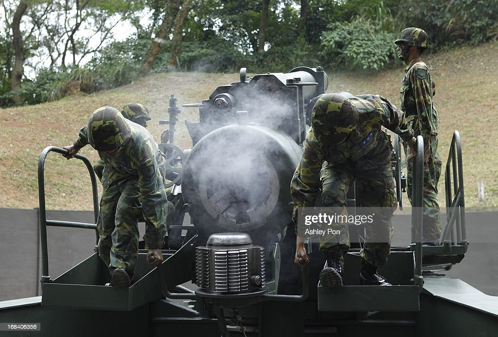 Army Soldiers operate a 240mm caliber Howitzer, which is Asia's biggest Howitzer, during a military drill as part of their routine military training in Nangan on May 8, 2013 in Matsu, Taiwan. The military held a routine drill on the unnamed base on the island which was opened up to the press by the Ministry of National Defence.