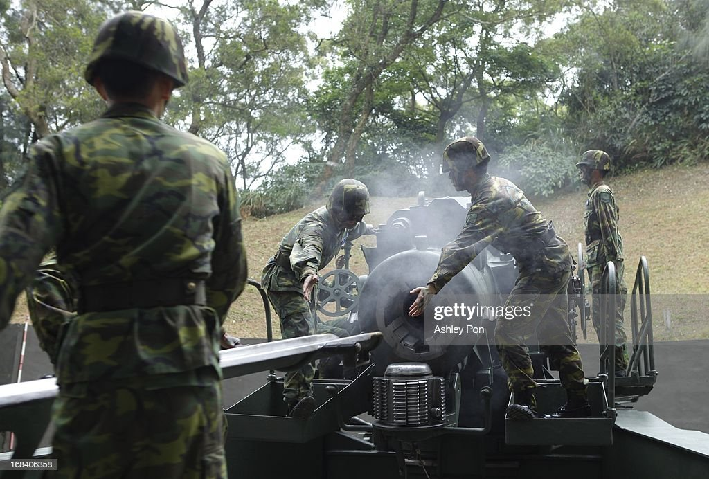 Army Soldiers operate a 240mm caliber Howitzer, which is Asia's biggest Howitzer during a military drill as part of their routine military training in Nangan on May 8, 2013 in Matsu, Taiwan. The military held a routine drill on the unnamed base on the island which was opened up to the press by the Ministry of National Defence.