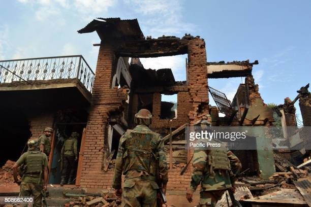 BAMNOO PULWAMA JAMMU KASHMIR INDIA Army soldiers outside a damaged house where militants had taken refuge during a gun battle at Bamnoo village Two...