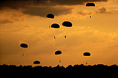 September 12, 2010 09/14/2009 U.S. Army Soldiers from the 82nd Airborne Division parachute down on to drop zone Luzon after jumping from a C09/14/2009130 Hercules during Airborne Operations at Fort Br