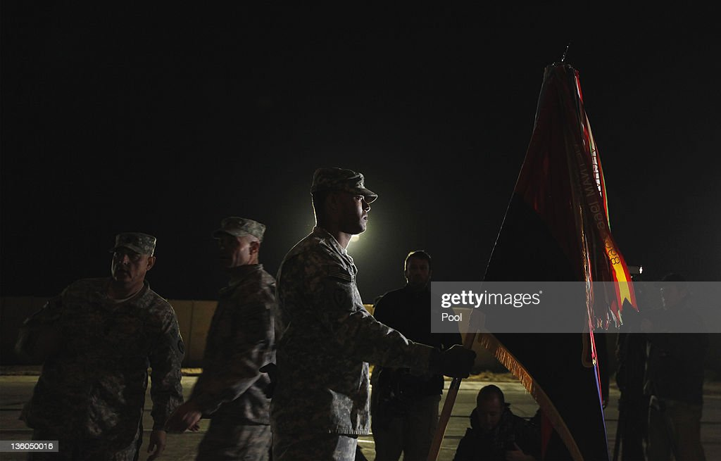 U.S. Army soldiers perform a casing of the colors ceremony signifying the departure of the 3rd Brigade Combat Team, 1st Cavalry Division as they depart in the last convoy from Camp Adder on December 17, 2011 near Nasiriyah, Iraq. All U.S. troops were scheduled to have departed Iraq by December 31st, 2011. At least 4,485 U.S. military personnel died in service in Iraq. According to the Iraq Body Count, more than 100,000 Iraqi civilians have died from war-related violence.