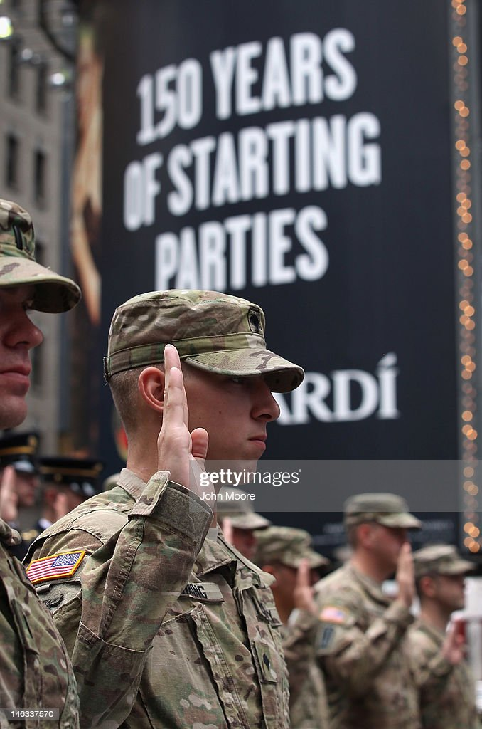 U.S. Army soldiers repeat an oath of allegience as U.S. Army Chief of Staff Gen. Raymond Odierno swears in new recruits on June 14, 2012 in Times Square in New York City. Odierno, fellow Army troops and New York dignitaries marked the 237th anniversary of the U.S. Army at the event.