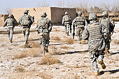 February 17, 2010 - U.S. Army soldiers respond to a small arms attack in Badula Qulp, Helmand province, Afghanistan, during Operation Helmand Spider.
