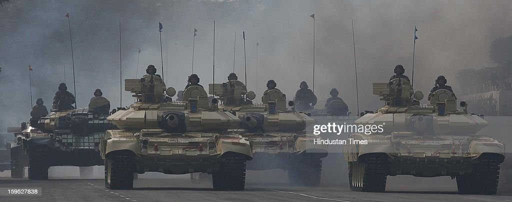 Army soldiers rides on a tank during the Army Day parade At Delhi cant on January 15, 2013 in New Delhi, India. The 65th anniversary of the formation of the Indian national army was celebrated with soldiers from various regiments and artillery units taking part in a parade.