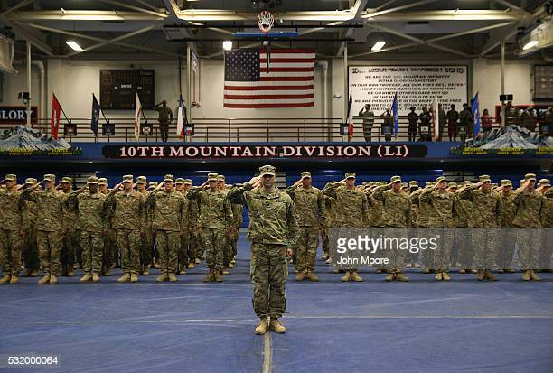 S Army soldiers salute during a welcomehome ceremony after from Iraq on May 17 2016 at Fort Drum New York More than 1000 members of the 10th Mountain...
