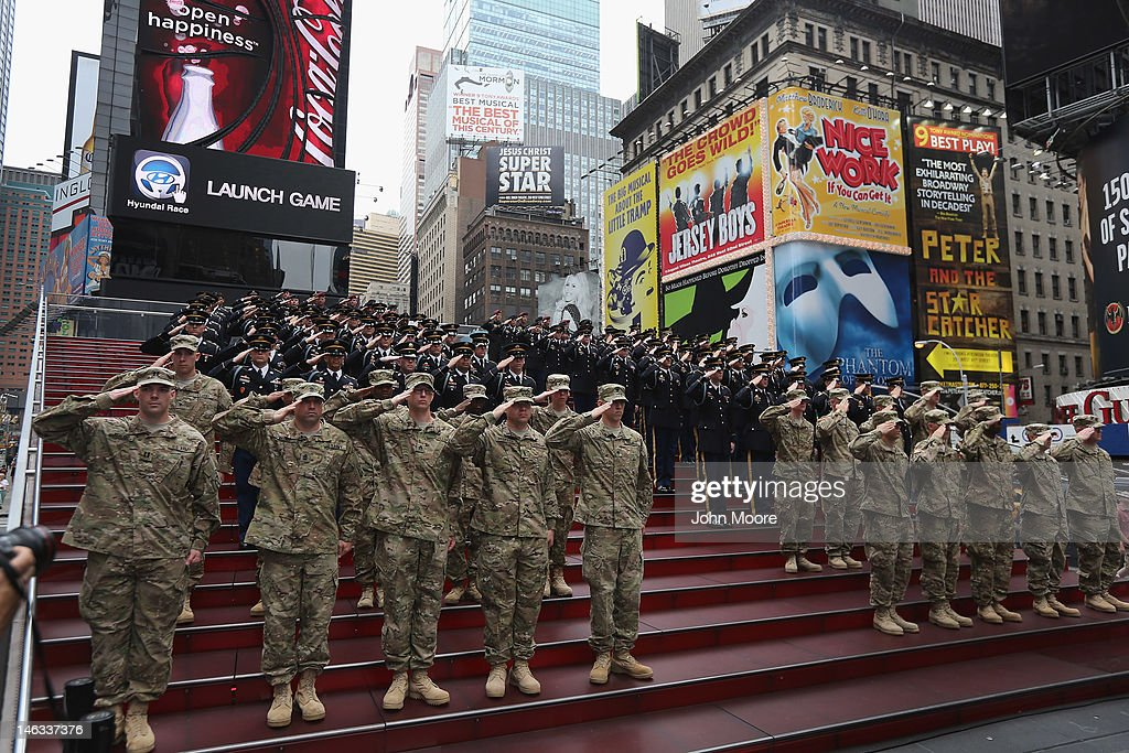 U.S. Army soldiers salute in Times Square during a ceremony where U.S. Army Chief of Staff Gen. Raymond Odierno led a celebration marking the Army's 237th birthday on June 14, 2012 in New York City. Odierno swore 16 new recruits into the Army during the event.