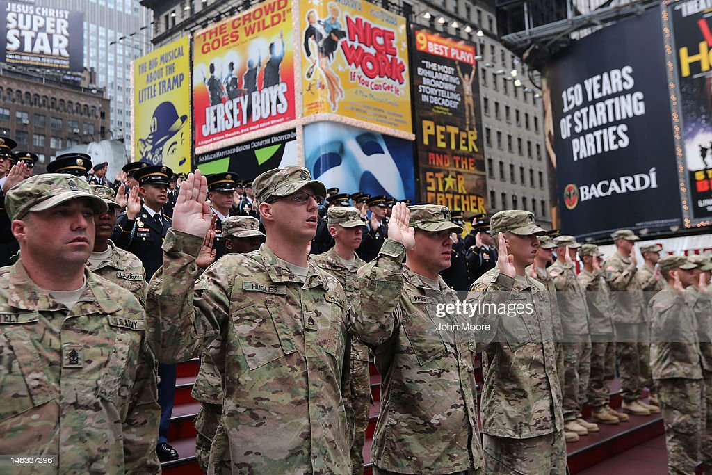 U.S. Army soldiers say an oath of allegience as U.S. Army Chief of Staff Gen. Raymond Odierno swears in new recruits on June 14, 2012 in Times Square in New York City. Odierno, fellow Army troops and New York dignitaries marked the 237th anniversary of the U.S. Army at the event.
