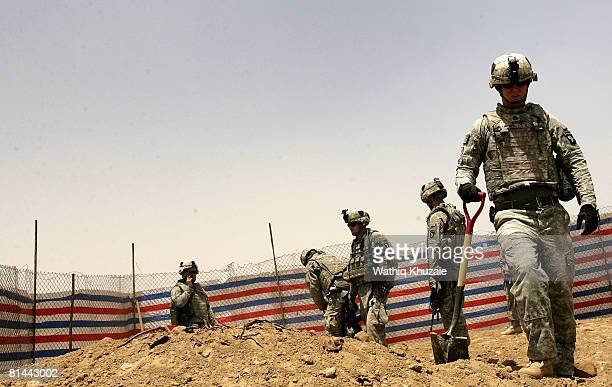 S Army soldiers search for weapons a cache in the courtyard of a house on June 5 2008 in the alRahmaniya Shiite neighborhood north of Baghdad Iraq US...
