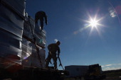 S Army soldiers secure portable meals from the Federal Emergency Management Agency onto delivery trucks in the aftermath of Superstorm Sandy on...