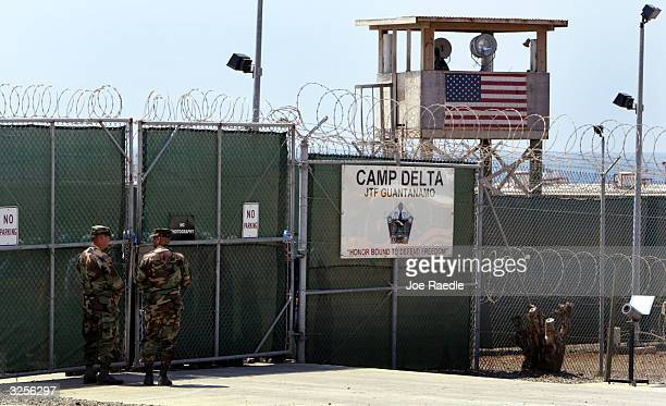S Army soldiers stand at the entrance to Camp Delta where detainees from the US war in Afghanistan live April 7 2004 in Guantanamo Bay Cuba On April...