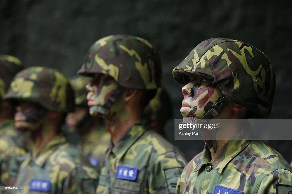 Army Soldiers stand guard during the Howitzer drill as part of their routine military training in Nangan on May 8, 2013 in Matsu, Taiwan. The military held a routine drill on the unnamed base on the island which was opened up to the press by the Ministry of National Defence.