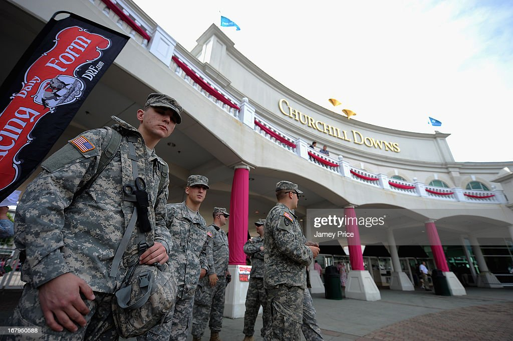 US Army soldiers stand guard near the entrance to Churchill Downs on May 3, 2013 in Louisville, Kentucky. Security at Churchill Downs has been increased and new measures put in place following the April 15 bombing at the Boston Marathon.