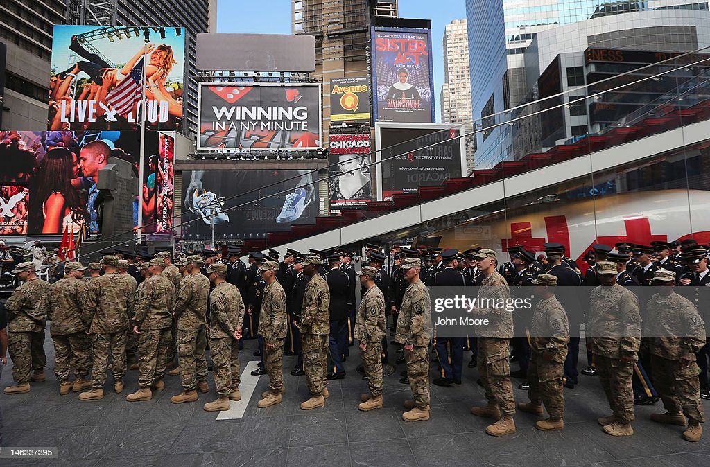 U.S. Army soldiers stand in Times Square before a ceremony where U.S. Army Chief of Staff Gen. Raymond Odierno swore in new recruits on June 14, 2012 in New York City. Odierno swore in 16 new recruits during the celebration marking the Army's 237th anniversary.