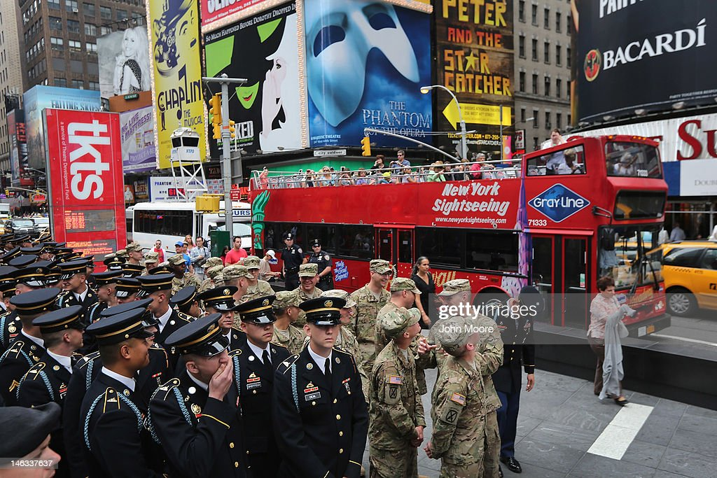 U.S. Army soldiers stand in Times Square before attending a ceremony where U.S. Army Chief of Staff Gen. Raymond Odierno swore in new recruits on June 14, 2012 in New York City. Odierno swore in 16 new recruits during the celebration marking the Army's 237th anniversary.