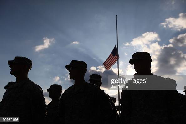 S Army soldiers stand together as they prepare to leave after the memorial service that US President Barack Obama and first lady Michelle Obama...