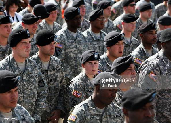 S Army soldiers stand together as they wait for the start of memorial service that US President Barack Obama and first lady Michelle Obama will...