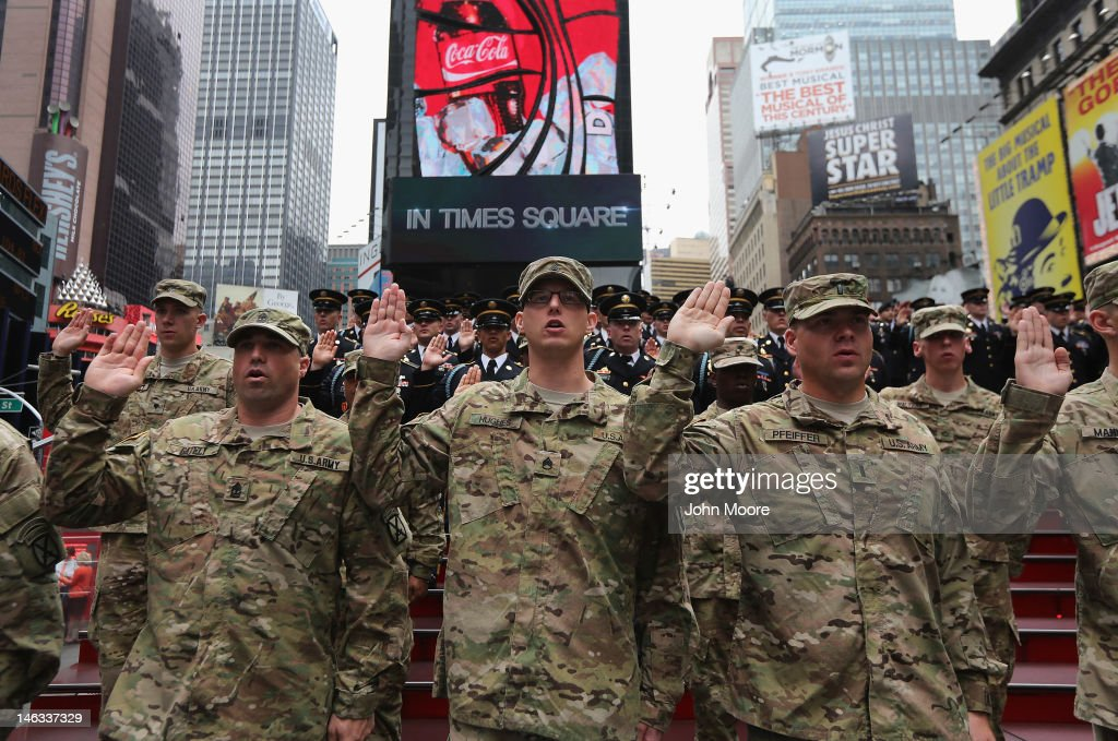 U.S. Army soldiers take an oath of allegience as U.S. Army Chief of Staff Gen. Raymond Odierno swears in new recruits on June 14, 2012 in Times Square in New York City. Odierno, fellow Army troops and New York dignitaries marked the 237th anniversary of the U.S. Army at the event.