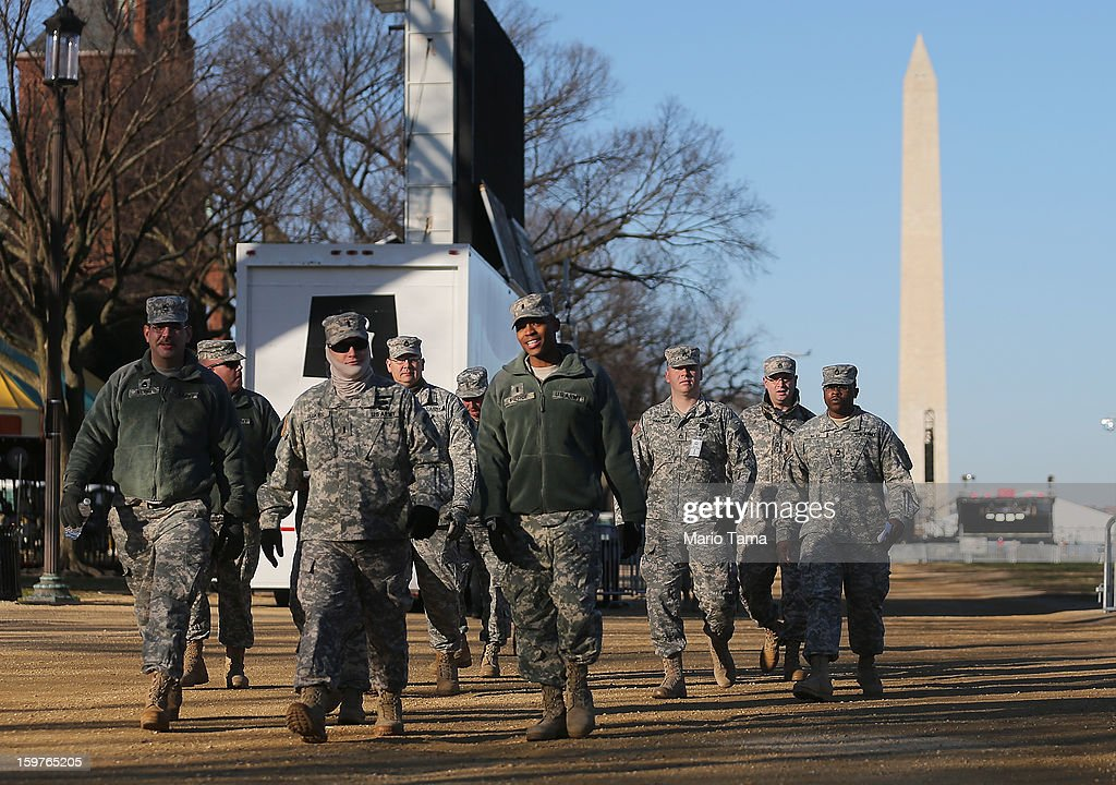 U.S. Army soldiers walk on the National Mall as Washington prepares for U.S. President Barack Obama's second inauguration on January 20, 2013 in Washington, DC. Both Obama and U.S. Vice President Joe Biden will be officially sworn in today with a public ceremony for the President taking place on January 21.