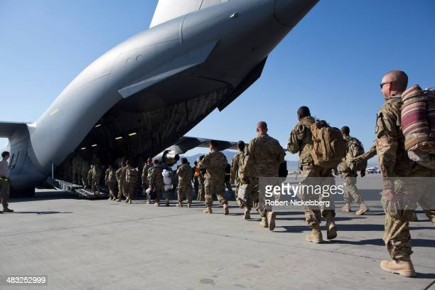 S Army soldiers walk to their C17 cargo plane for departure May 11 2013 at Bagram Air Base Afghanistan US soldiers and marines are part of the NATO...