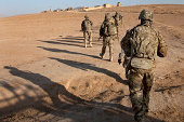 U.S. Army soldiers walk toward a checkpoint in Afghanistan.