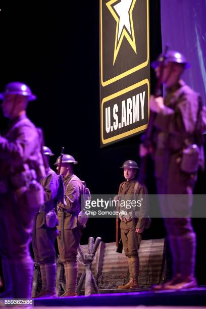 S Army soliders performing a singing salute to their warfighters from World War I to today during the Association of the United States Army's annual...