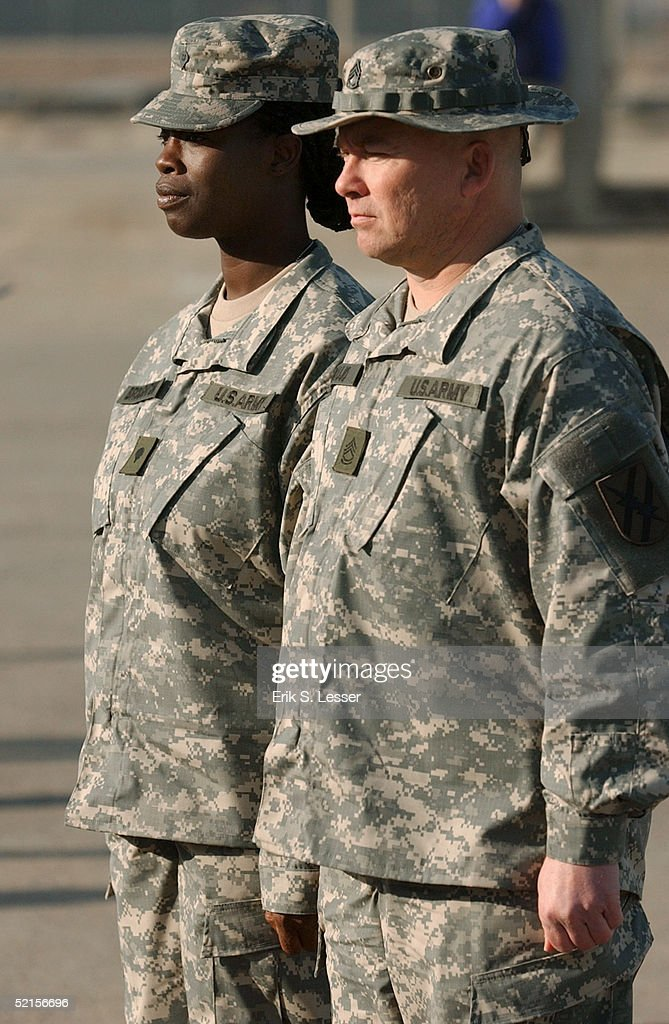 U.S. Army Spc. Cynthia Broughton (L) and Sgt. Daniel Araujo (R), with the Georgia National Guard's 48th Infantry Brigade, model the U.S. Army's new Army Combat Uniform (ACU) February 8, 2005 at Fort Stewart, Georgia. The ACU includes a new universal camouflage pattern and provides moisture wicking, functionality and ergonomics.