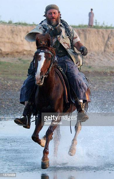 S Army Special Forces soldier nicknamed 'Bones' rides his horse 'Kabob' during a horseback presence patrol August 25 2002 in the town of Kunduz in...