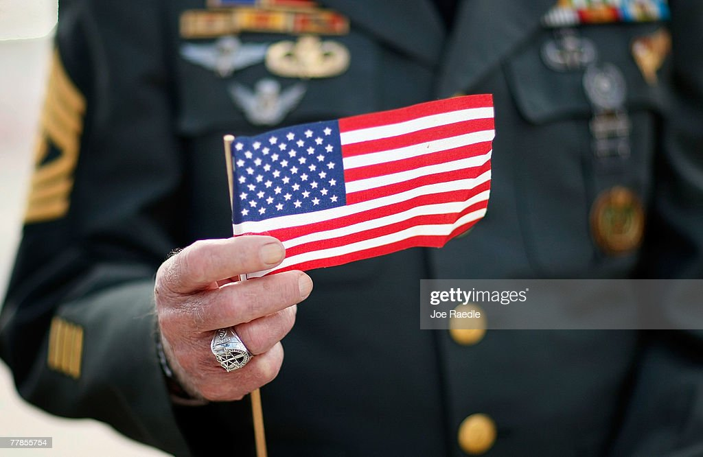 Army special forces vet Tony Junot holds an American flag during a Veterans Day ceremony November 12 2007 in Miami Beach Florida Veterans Day honors...