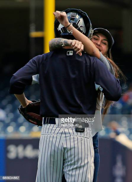 S Army Specialist Daniel Paredes gets a hug from his wife Selena after surprising her on his return from Iraq Selena threw out the first pitch before...