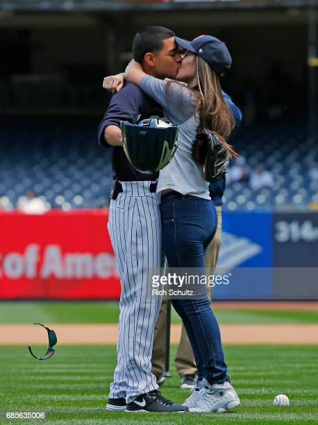 S Army Specialist Daniel Paredes kisses his wife Selena after surprising her on his return from Iraq Selena threw out the first pitch before game one...