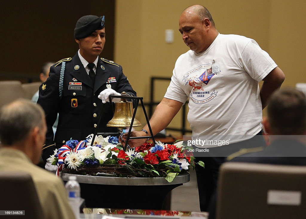 U.S. Army Specialist Juan Aguero, from the Florida National Guard Honor Guard, stands beside a bell as William Ortega rings the bell in honor of his son, William Ortega, Jr, during a ceremony to remember and honor those who have died in service to the nation and the families they have left behind at U.S. Southern Command headquarters on May 20, 2013 in Doral, Florida. U.S. Marine Gen. John Kelly presided over the ceremony where the families of 57 fallen service members from South Florida were invited to attend.