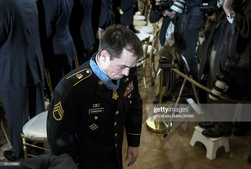 Army Staff Sargent Clinton Romesha leaves after a Medal of Honor ceremony in the East Room of the White House February 11, 2013 in Washington, DC. Romesha was awarded the Medal of Honor for his service during an insurgent attack on Combat Outpost Keating in Afghanistan. AFP PHOTO/Brendan SMIALOWSKI