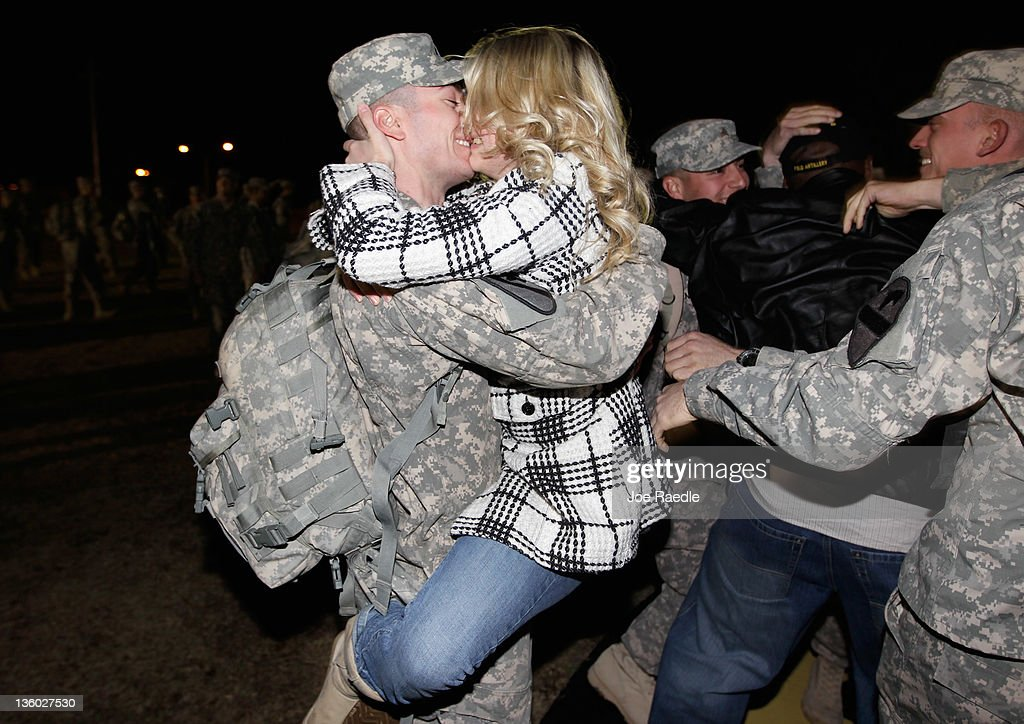 U.S. Army Staff Sergeant Chad Johnson from the 2-82 Field Artillery, 3rd Brigade, 1st Cavalry Division, is greeted as he arrives at the home base of Fort Hood, Texas after being part of one of the last American combat units to exit from Iraq on December 16, 2011 in Fort Hood, Texas. The U.S. military formally ended its mission in Iraq after eight years of war and the overthrow of Saddam Hussein.