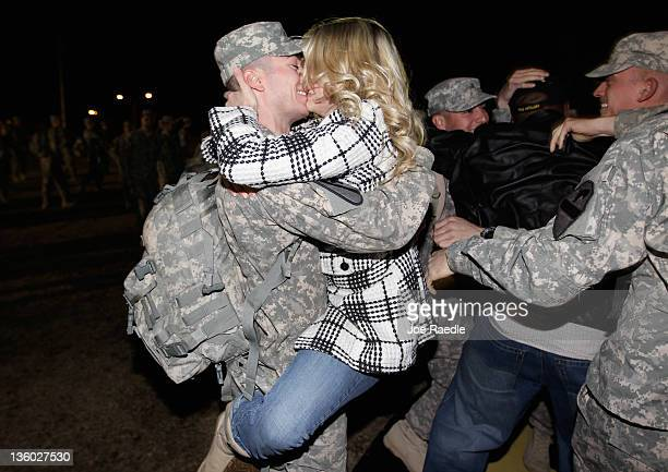 S Army Staff Sergeant Chad Johnson from the 282 Field Artillery 3rd Brigade 1st Cavalry Division is greeted as he arrives at the home base of Fort...