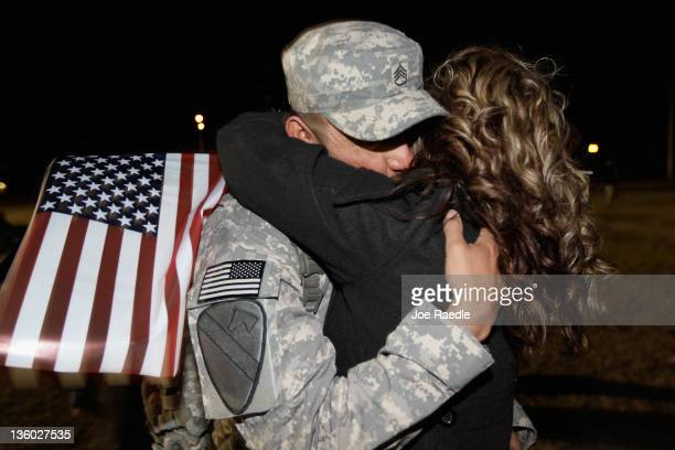 S Army Staff Sergeant Myles James from the 282 Field Artillery 3rd Brigade 1st Cavalry Division is greeted as he arrives at the home base of Fort...