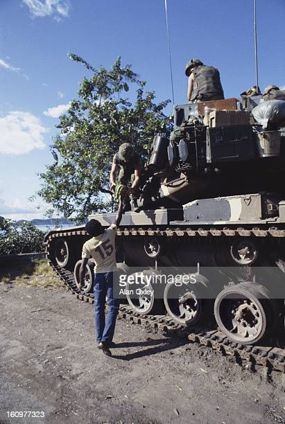 Army tank crew gets a gift of bananas from a local resident near St Georges during the US invasion of Grenada in Oct 1983