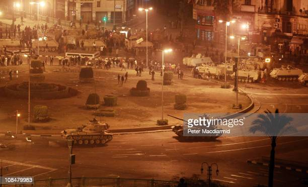 Army tanks line up in Tahrir Square on January 28 2011 in Cairo EgyptThousands of police are on the streets of the capital Hundreds of arrests have...