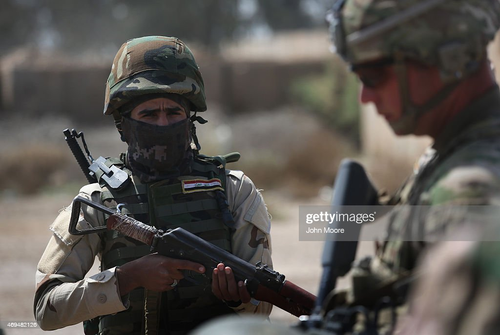 S Army trainer instructs an Iraqi Army recruit at a military base on April 12 2015 in Taji Iraq US forces currently operating in 5 large bases...