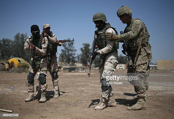 S Army trainer instructs Iraqi Army recruits at a military base on April 12 2015 in Taji Iraq US forces currently operating in 5 large bases throught...