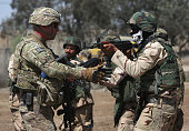 S Army trainer instructs Iraqi Army recruits at a military base on April 12 2015 in Taji Iraq Members of the US Army's 573 CAV 3BCT 82nd Airborne...