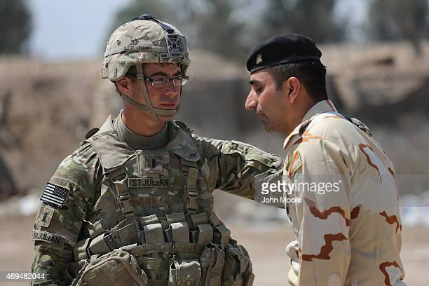 S Army trainer speaks with an Iraqi Army officer at a military base on April 12 2015 in Taji Iraq US forces currently operating in 5 large bases...