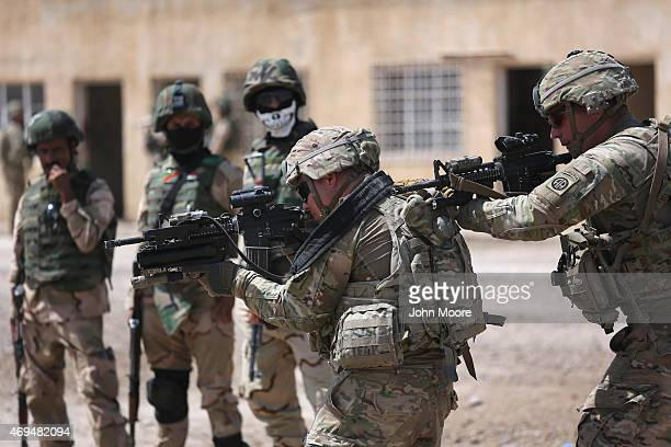 S Army trainers instruct Iraqi Army recruits at a military base on April 12 2015 in Taji Iraq US forces currently operating in 5 large bases throught...