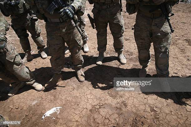 S Army trainers watch as Iraqi Army recruits train at a military base on April 12 2015 in Taji Iraq Members of the US Army's 573 CAV 3BCT 82nd...
