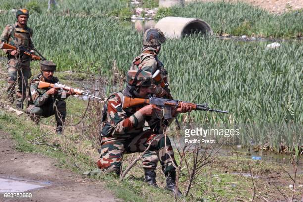 Army troopers taking positions after the suspected militants carried out an ambush on their convoy in Bemina area of Srinagar in Indian Controlled...