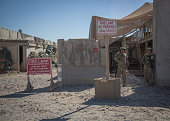 Army troops stand beside an accommodation block at Kandahar airfield on November 14 2014 in Kandahar Afghanistan Now that British combat operations...
