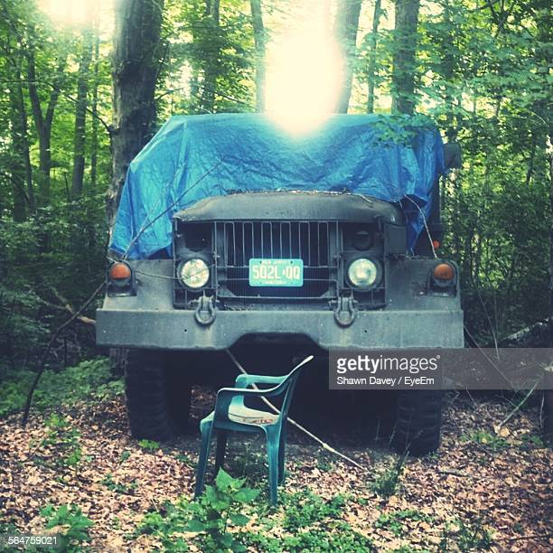 Army Truck Covered With Tarpaulin In Forest