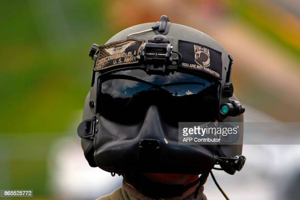 Army UH60 Blackhawk helicopter is reflected on Sgt Bradley Obenland crewmember before taking off from a delivery mission residents affected by the...