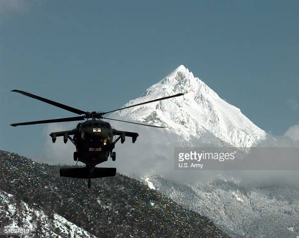 A US Army Uh60 Blackhawk Helicopter Loaded With Tourists Stranded By An Avalanche Comes In For A Landing Near Landeck Austria On February 25 1999...