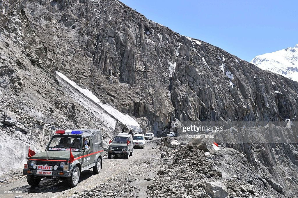 Army vehicles cross through a snow bound Zojila pass, 108 kilometers (67 miles) east of Srinagar, on April 30, 2016 in Srinagar, India. The Srinagar-Leh road link was thrown open for vehicular traffic after around five months. India's Border Roads Organisation (BRO) which maintains the road opened it after clearing the snow from Zojila Pass, 3630 meters above sea level. The 434-km Srinagar-Leh National Highway, the only road linking Kashmir with frontier region of Ladakh, has been partially thrown open to vehicular traffic after remaining closed for over six months owing to heavy snowfall during winter. The Pass attracts the heaviest snowfall during the winter and as such it remains closed to traffic for five to six months in a year.