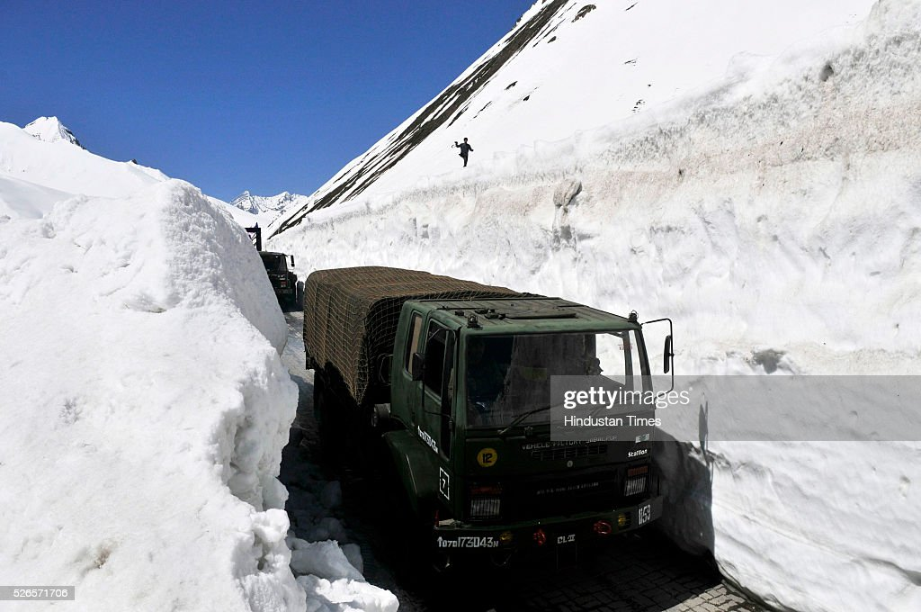 Army Vehicle cross through a snow bound Zojila pass, 108 kilometers (67 miles) east of Srinagar, on April 30, 2016 in Srinagar, India. The Srinagar-Leh road link was thrown open for vehicular traffic after around five months. India's Border Roads Organisation (BRO) which maintains the road opened it after clearing the snow from Zojila Pass, 3630 meters above sea level. The 434-km Srinagar-Leh National Highway, the only road linking Kashmir with frontier region of Ladakh, has been partially thrown open to vehicular traffic after remaining closed for over six months owing to heavy snowfall during winter. The Pass attracts the heaviest snowfall during the winter and as such it remains closed to traffic for five to six months in a year.